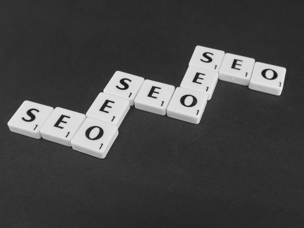 """These are scrabble tiles spelling """"SEO""""."""